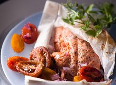 Baked salmon with cherry tomatoes and red onion paper parcels Recipe - EatOut
