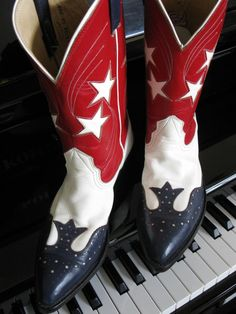 All American Red White and Blue Vintage Leather Nocona Boots. Made in the USA.  Star shaped cut outs on the shaft of the boot with white shooting star stitching. The blue leather overlay on toe and heel with white dot pattern cut out and red stitching reminds me of oxford shoes. Amazing attention to detail!    clotheswhorse, $410.00
