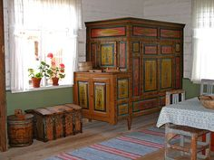 I adore these painted cabinet beds in Sweden... they used to build a cupboard and secretary and other such things (cabinet) in one end, sort of to disguise the fact that this indeed is a bed.