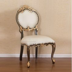 Image from http://www.batefurniture.com/wp-content/uploads/2013/12/CH8440B-Black-Gold-French-Chair.jpg.