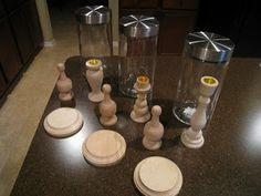 purchased at Hobby Lobby ~3 unfinished wooden candle sticks~ $2.00 each, 3 unfinished wooden finials~ $1.00 each, 3 medium sized wooden b...