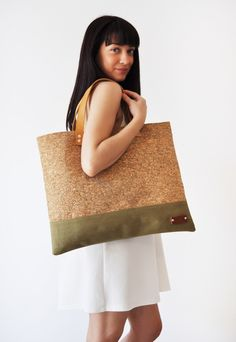 Flat shoulder bag featuring mosaic cork and khaki cotton belt at the bottom…