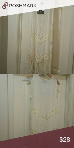 """NWT Angie fringe vest NWT white, open front vest with fringe. Hangs aprox 41"""" from top of shoulder to bottom of fringe. Angie Jackets & Coats Vests"""