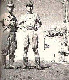 What appears to be two Imperial Japanese Army Air Force soldiers posing on the runway of an unidentified airfield with the flight control tower in the background - Pin it by Gustavo Bueso-Jacquier