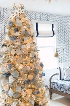 Vintage Decor Rustic Gorgeous Christmas tree decorated in blue, white, silver, and gold with white poinsettia accents Flocked Christmas Trees Decorated, White Christmas Tree Decorations, Elegant Christmas Trees, Silver Christmas Decorations, Silver Christmas Tree, Christmas Tree Design, Christmas Home, Christmas Mantles, Purple Christmas