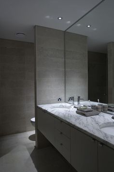 bathroom  Lighter wall tiles, lose the door handles and add a skylight for natural light