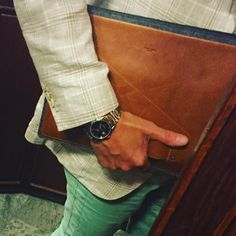 A refined felted wool folio that features a large outside leather pocket and a grab handle. Hard Graft, Surface Pro, Macbook Case, Dandy, Laptop Sleeves, Wool Felt, Pocket, Classic, Leather