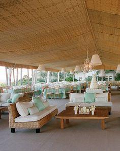 Gorgeous open air lounge at a beach wedding reception