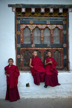 Here is a group of young monks from Bhutan .You can tell that there monks because of there robe ,and there bald . There are a bunch of young monks in Bhutan