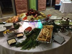 Stationary Display of Cheeses, Brie, Raw Vegetable Crudite, and Crackers for a Holiday Party - Jules Catering