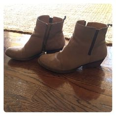 Nine West taupe suede booties These beautiful suede boots have some slight signs of wear (see photos) but are in overall fantastic condition. Exposed zipper on the inside, and a slight one inch heel. Color is a grayish taupe beige. Beautiful fall/winter piece! Nine West Shoes Ankle Boots & Booties