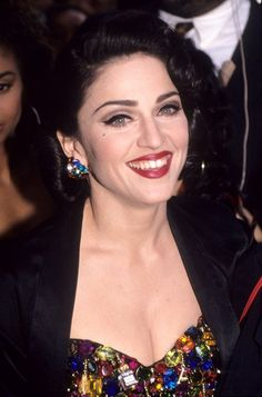 Pin for Later: Madonna's Beauty Style Is as Classic as Her Music 1991 A faux mole and retro curls gave Madonna a vintage pinup-girl appeal.