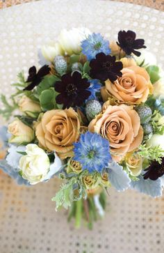 Love this combo of peach and blue, with striking eggplant-colored anemones