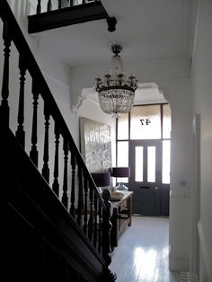 the drama of this entryway - 47 Park Avenue. Edwardian Staircase, Victorian Terrace Hallway, Edwardian Hallway, French Chic Paint, Parisian Chic Decor, Painted Stairs, Painted Floorboards, Interior Decorating, Interior Design