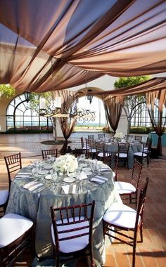 oceanfront wedding at the double tree in santa barbara, Blue and white wedding, with taupe touches, fabric draping and chandeliers!