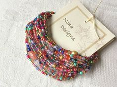 Festival Colors! A long strand of beautiful beads you can wrap around your wrist or neck. This design includes colorful faceted Candy Jade, Cherry Quartz Glass, Faceted Czech Glass and many other bright glasses and seed beads. It is a generous 87 long on strong stretch cord and will wrap