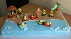 Minion Beach Party Cake! A 10 by 20 inch chocolate cake with strawberry frosting, covered in crushed vanilla wafers and blue fondant. Royal icing creates the sea foam. The minions (~1 inch in height) and accessories are made completely with gum paste and hand painted! Such a fun cake!