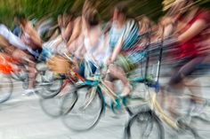 Zooming in picture with cyclists on their bikes - Zooming in picture with cyclists on their bikes. Abstract image depicting the speed of cyclists