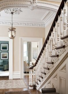 Amazing stairs, crown moulding, ceiling medallion, pendant light, arched door, thick trim - the list goes on and on!