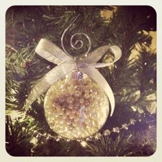 Put broken pearl necklace in glass ball ornament. Put burlap bow?