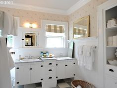 Cute little bathroom-built ins, love the hinges, and seperation of vanities.