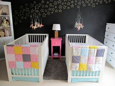 twin nursery chalkboard wall pink yellow aqua pinwheels