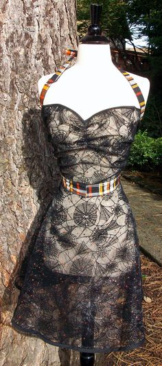 Spiderwebs, sparkles and plaid! Oh my! $45