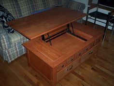 Lift up coffee table.  Lasted me 8 years+