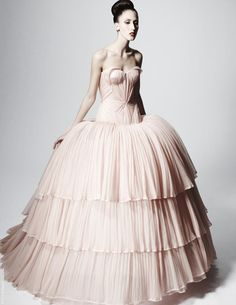 1.Elaborate puffs of fabric at the hips.   Zac Posen Pre Fall 2013  stylesight.com