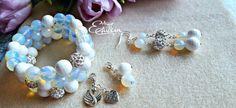 Tender set. Bracelets with pendants, earrings