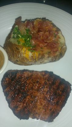 Blackened Filet Butterflied with Peppercorn Sauce and Loaded Baked Potatoe at Brimstone