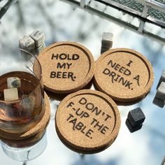 """Drinks Are on Us - wood burned cork Coasters • 4 pack • 4"""" Diameter • Funny Sayings: """"I Need a Drink"""" """"Don't F-Up the Table"""" """"Hold My Beer"""" """"Drinks are on Me"""""""
