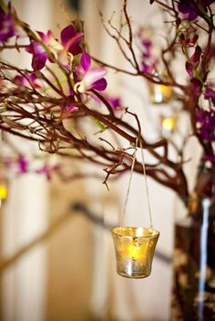 Hang tea lights from your centerpiece's branches. What a soft touch! I like this :)