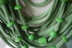 Upcycled t-shirt scarf: Soft green with wooden beads [369] by StripsUp on Etsy
