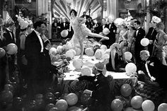 This picture not only represents the 1920's luxurious and party-like lifestyle, but it is also a good representation of Gatsby's party lifestyle. In this picture, a flapper performer is visible in the center platform; this was a popular aspect of these parties. You can also see some of the architecture of those houses most famous for throwing parties.