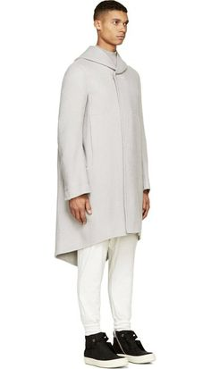 Pearl Grey Cashmere Hooded Coat by Rick Owens. Long sleeve hooded cashmere fleece coat in pearl grey. Single press-stud closure at throat. Seam pockets at sides. Fishtail hem. Tonal stitching. Single press-stud at sleeve cuffs. Body: 100% cashmere. Sleeve lining: 100% viscose.  http://www.zocko.com/z/JHlHV
