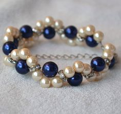 navy blue and champagne pearl bracelet,navy pearl and champagne pearl bracelet, navy glass bead bracelet, mixed color pearl bracelet by glasspearlstore on Etsy https://www.etsy.com/listing/242465303/navy-blue-and-champagne-pearl