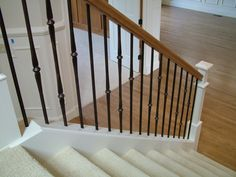 Wood Staircases With Iron Balusters Wood Handrail, Wood Staircase, Staircase Ideas, Banisters, Staircases, Stair Railing Design, Iron Stair Railing, Iron Balusters, Railing Ideas
