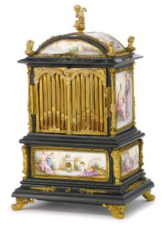 A painted enamel music box in the form of an organ cabinet, probably Vienna, circa 1900