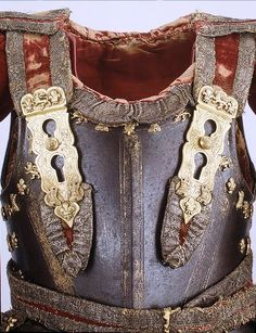 Metal breastplate, circa war of the roses 1455-1485. Worn over a buff coat, likely noble but not royal.