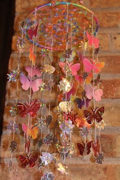 This dream catcher mobile was made by my mom. She has been making dream catchers for over 15 years. I love how this one sparkles.  Click on the picture and see more sides of this. fascinating!