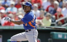 New York Mets' Curtis Granderson watches his ground-rule double during the first inning of an exhibition baseball game against the St. Louis Cardinals on Sunday, March 2, 2014, in Jupiter, Fla. (AP Photo/Jeff Roberson)