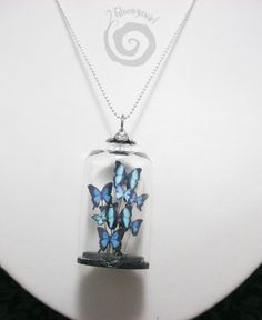 Peculiar Blue Butterflies Large Glass Dome Entomology Necklace. $40.50, via Etsy.