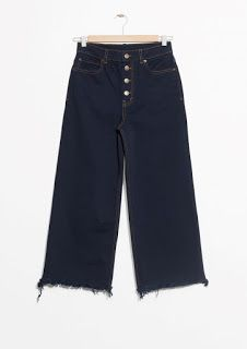 The cropped legs with raw endings and exposed button zip define these navy blue denim jeans. Flared look, legs Length of inseam: 64 cm (size Model wears: EU UK US 6 Blue Denim Jeans, Dark Denim, Denim Trends, Cool Jackets, Oversized Shirt, Fashion Editor, Feminine Style, Signature Style, Shirt Blouses