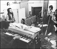 The Beatles in Abbey Road Studios recording Let It Be. Pictured bottom left is keyboardist, Billy Preston, who was invited to sit in on some of the sessions.