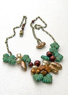 https://www.etsy.com/treasury/Njk4OTA1NnwyNzI1MDI3ODE0/into-the-blue-green-wonder Green brown Bead Necklace Floral Jewelry by CherylParrottJewelry, $71.95