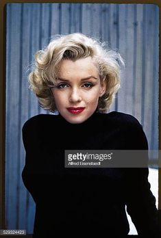 Portrait of American actress Marilyn Monroe as she poses on the patio outside of her home Hollywood California May 1953