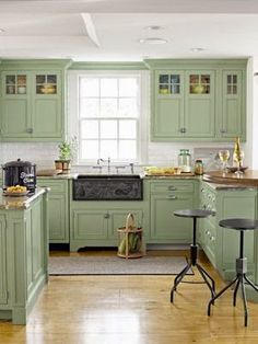 What a pleasing country kitchen design. The sage green kitchen cabinets are a beautiful color. And don't miss the custom-carved apron-front sink made of slate. Green Kitchen Cabinets, Kitchen Redo, New Kitchen, Kitchen Ideas, Upper Cabinets, Colored Cabinets, Mint Kitchen, Pastel Kitchen, Kitchen Colors