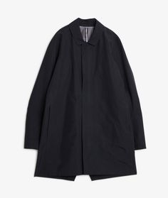 A three-quarter length overcoat, with a classic silhouette modeled after the original Partition Coat, but now with a slightly bigger fit sized for layering.