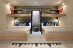Interior Design Ideas For Sleeping Six People In A Room // These bunk beds are positioned around a window, so not to block the natural light from entering the space. The room, designed by Kaegebein Fine Home Building, has two double beds underneath the top two single bunks, to allow it to comfortably sleep 6.